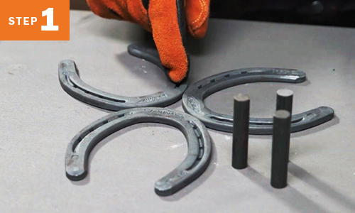Three horseshoes placed together with three stocks next to them