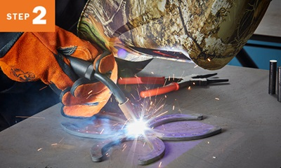 Welding tack welding three horseshoes together