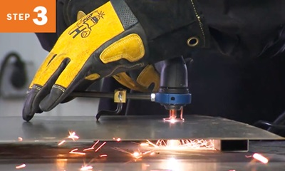 Closeup of cutting metal with a plasma cutting torch